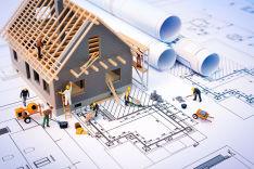 Haus auf Planungsunterlagen